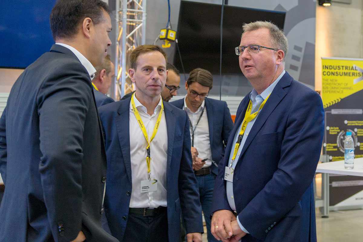 SupplyOn's Werner Jannings and Hermann Schindler talking to Christian Titze from Gartner (from left to right)