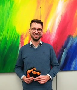 Beaming with pride: contest winner Christian, Product Owner SRM